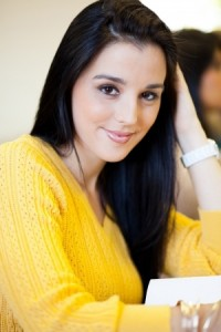 attractive girl in yellow sweater