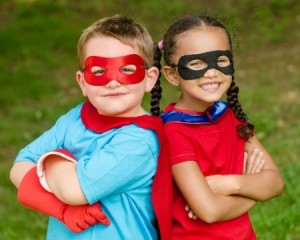 kids dressed up as superheroes