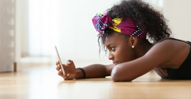 girl looking at phone fear