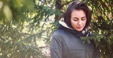 shy girl in trees